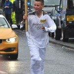 Logan Jones carried the Olympic torch into Amble