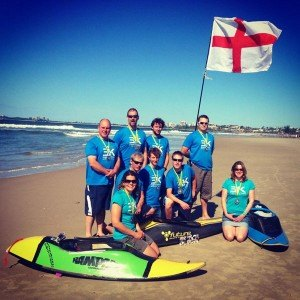 Dan (holding flag) and Tamsin (right) with the England Surf Kayak team Photo by Chris Elesmore