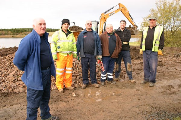 Graham Mitcheson (left) with County Council staff, contractors and volunteers, finishing the improvements to the watersports facilities at Druridge Bay Country Park