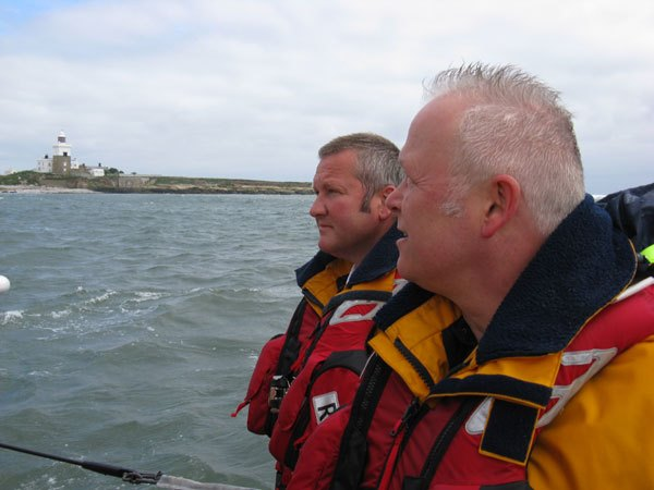 Simon Baxter, Alan Stewart in front of Coquet Island