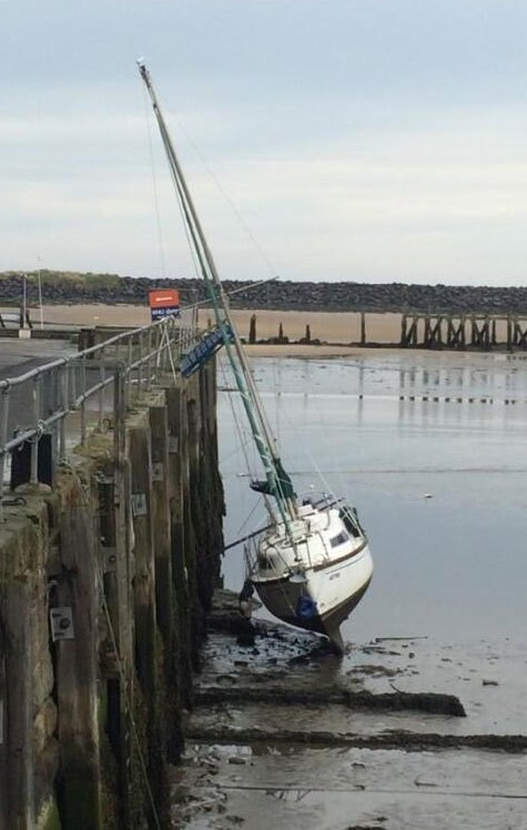 boat-aground-in-dock