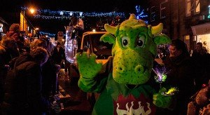 Top: Dexter dragon waves to the crowd. The Christmas Lights procession was the biggest Amble has seen.