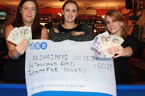 Gemma hands over cheque to Alzheimer's Society