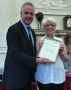 Christine Waters is presented with her commendation certificate