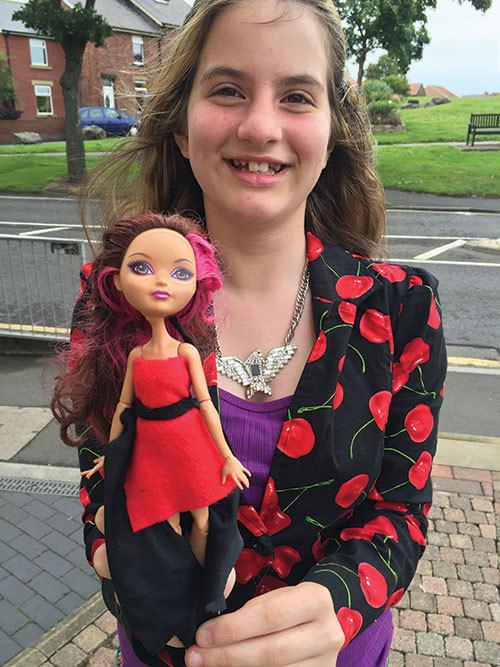 Emma-Jane with one of her doll dress designs