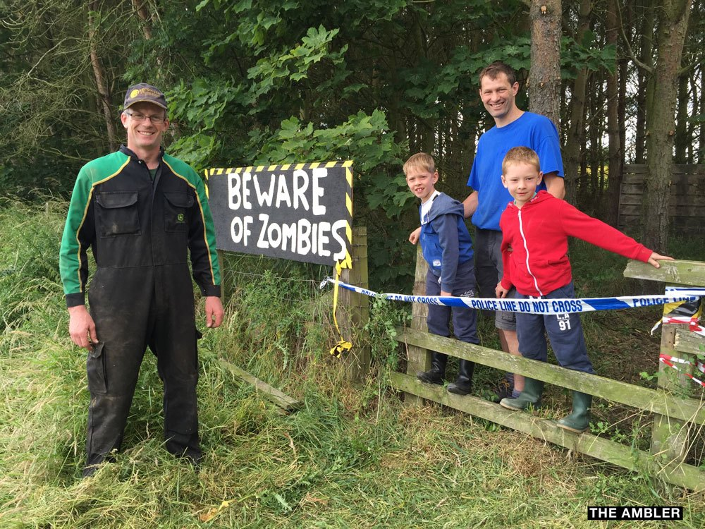 Farmer Alan Conway with Zombie Run course designer Matthew Currie and his 6 yr old twins Finn and Joe