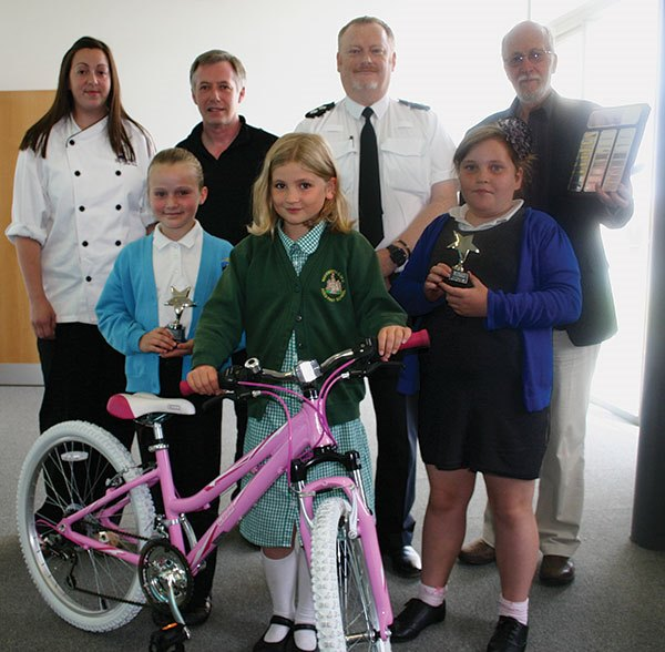 (clockwise l-r) Hannah Jobson from Spurreli, CSO Darin Fawcett, Inspector Paul Truscott of Northumbria Police, Prof John Hobrough, Chair of Governors of Warkworth First School, Amber Lewins (9) from Amble Links First School, Ava Tibbitts from Warkworth First School and Abby Coulter (9) from Edwin Street School