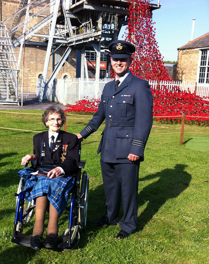 "British Legion member and WW2 veteran Edith Hunter of Amble was a guest of honour at the preview opening of the ""Weeping Window Sculpture"" which features 5,000 handmade ceramic poppies at Woodhorn Museum. Edith is pictured with Wing Commander Gareth Taylor RAF Boulmer."