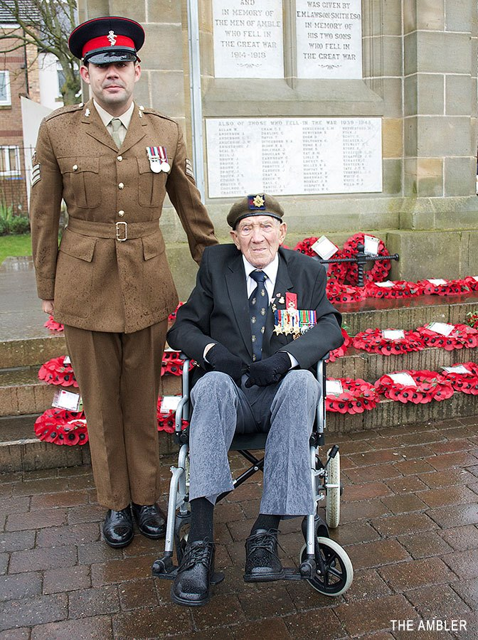 George Skipper and his grandson Sgt Luke Skipper placed a poppy wreath at Amble war memorial on Remembrance Day