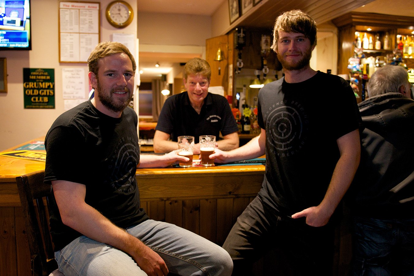 Michael Graham and Matt Taylor with Mason's Arms landlord Nigel Wilson behind the bar
