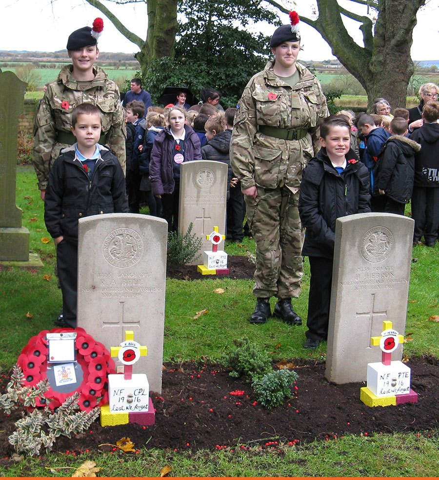 Children from Broomhill, Red Row and Acklington First Schools placed tributes on the graves