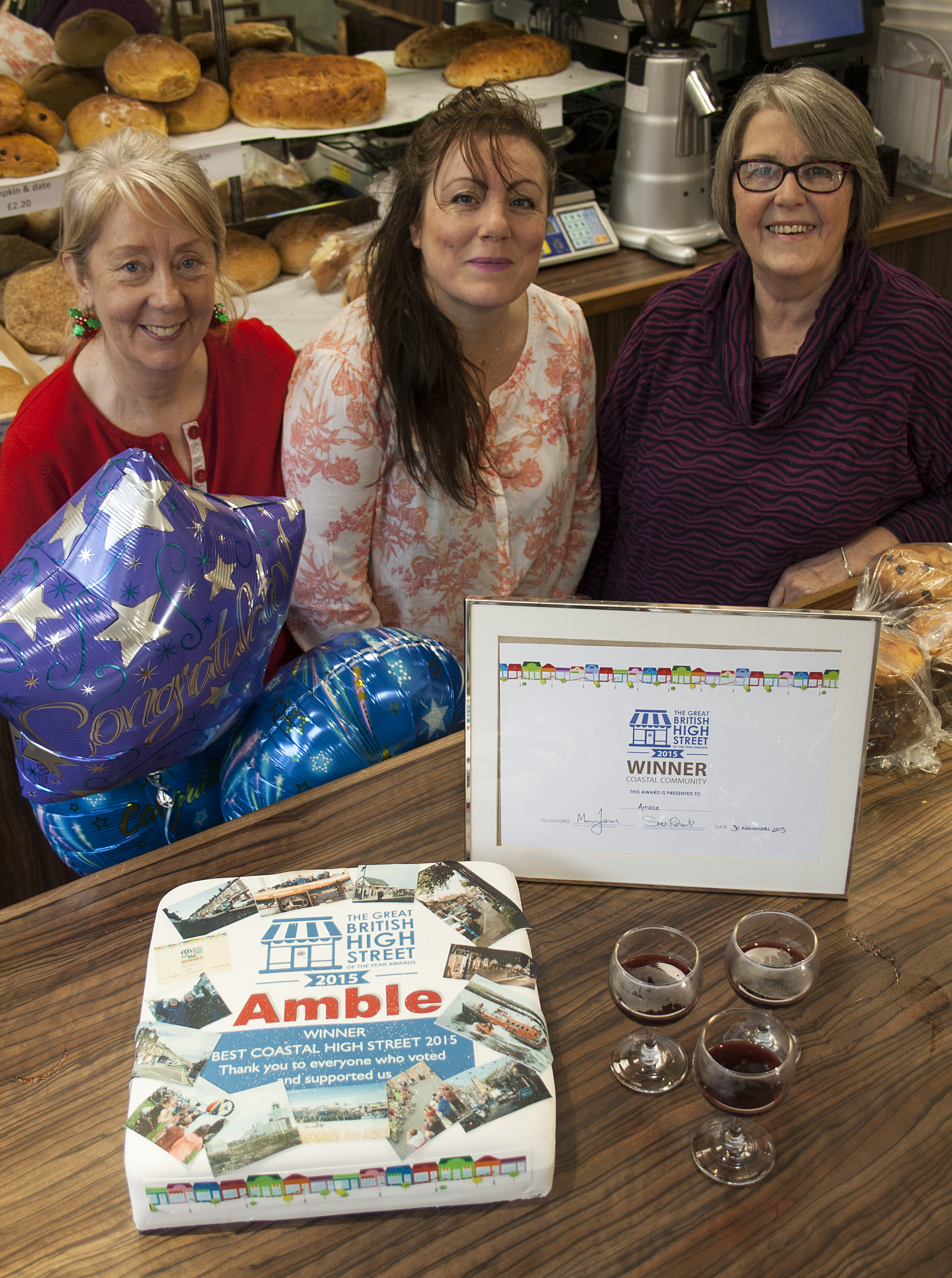 Julia Aston, Ruth Charlton and Ann Burke with celebration cake