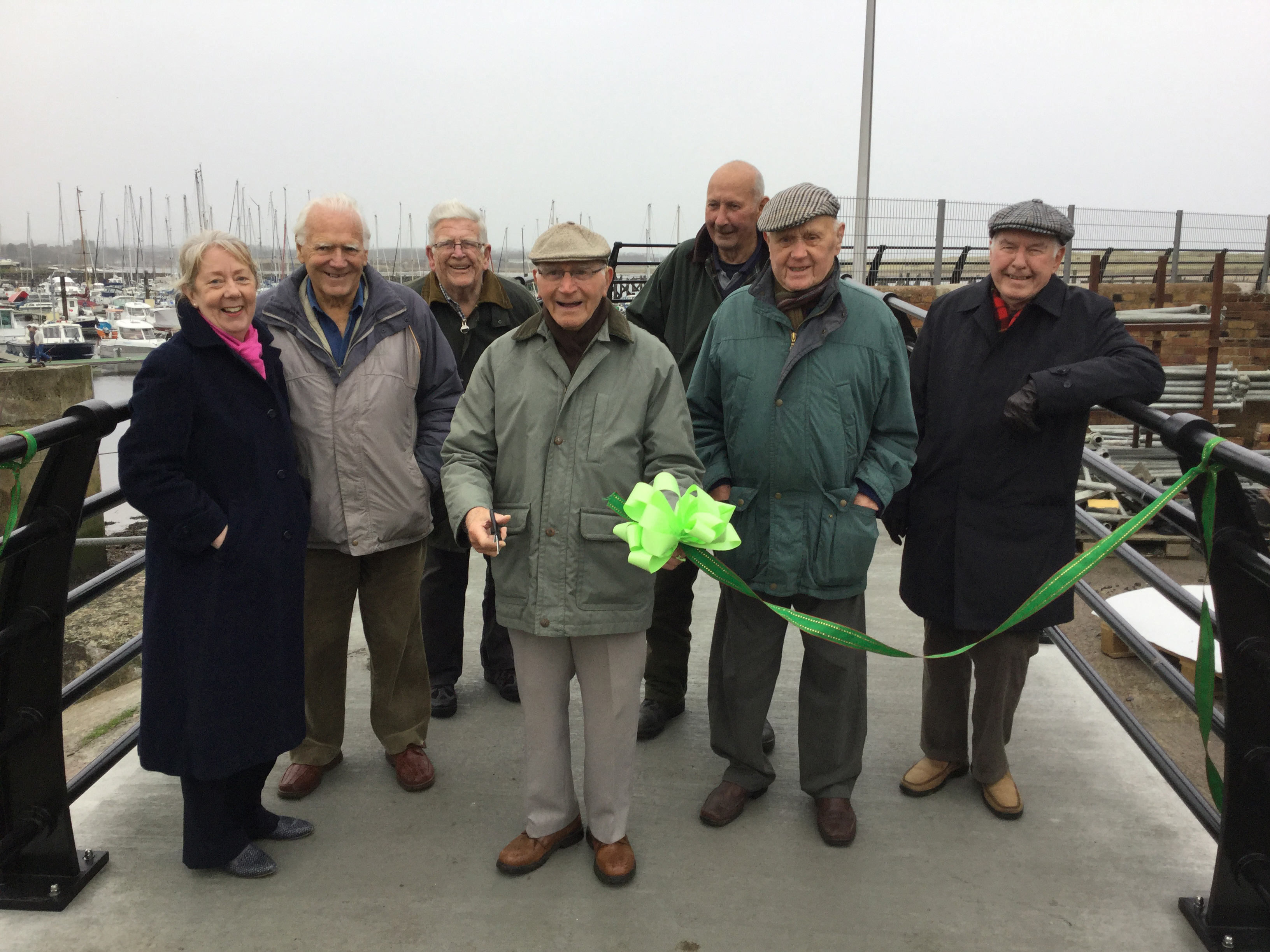 "Coble Quay walkway is now open. Here are the ""Harbour Gadgies"" with Julia Aston of Amble Development Trust cutting the ribbon. l-r Julia Aston, Michael Mather, Les Thompson,James Pringle, Dave Doleman, Sid Tasker and Brian Wallace"