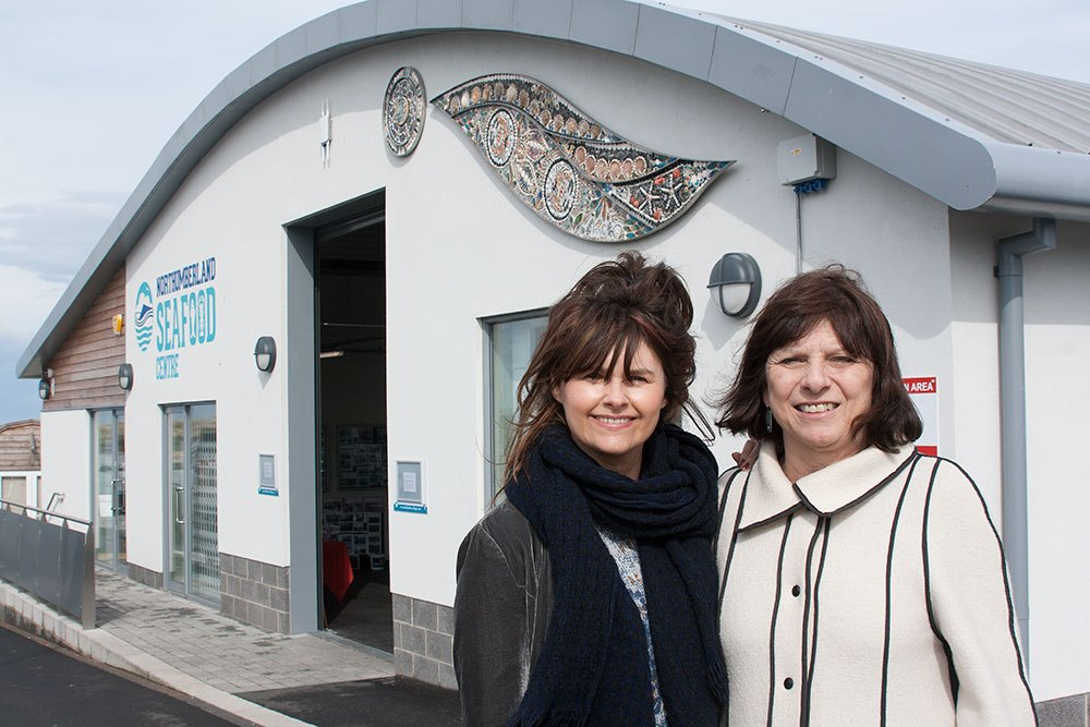l- r Julie Smith and Judith Bulmer with the mosaic on the Seafood Centre