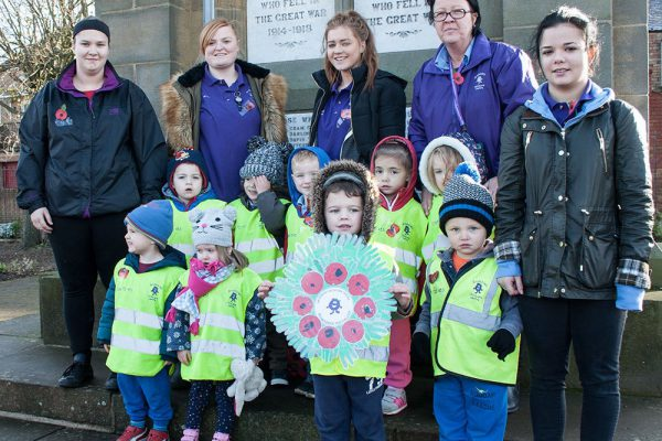 Amble children pay their respects to the fallen