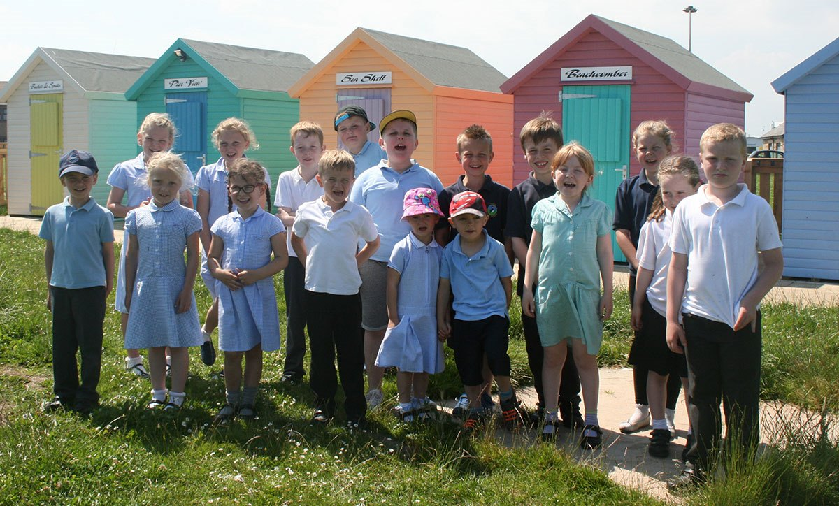 Amble-Links-children-and-beach-huts