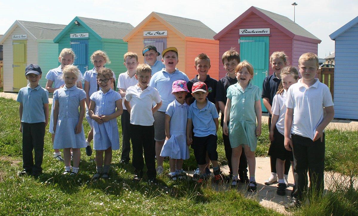 Amble-Links-children-and-beach-huts
