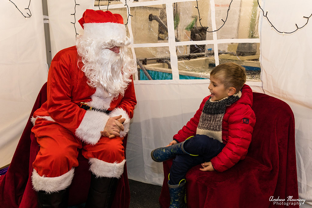 little boy chatting to Santa