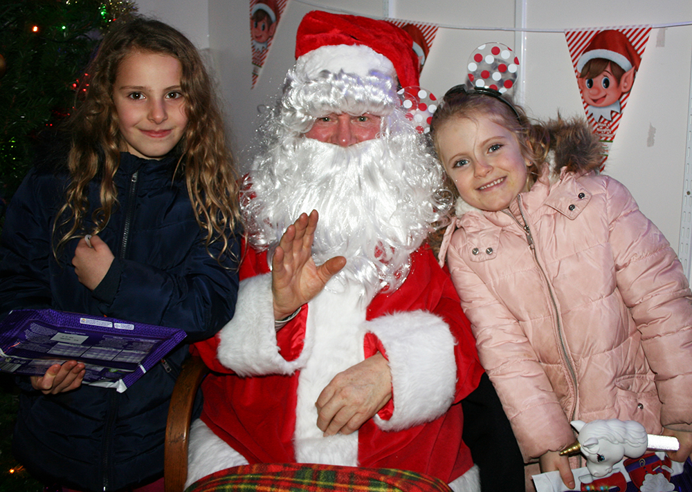 Emelia and Hannah with Santa web