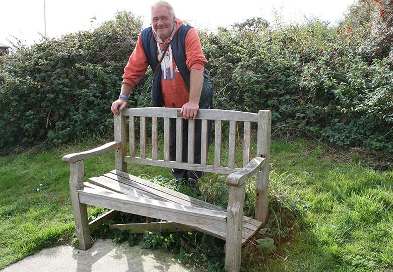 John Arries with broken memorial seat