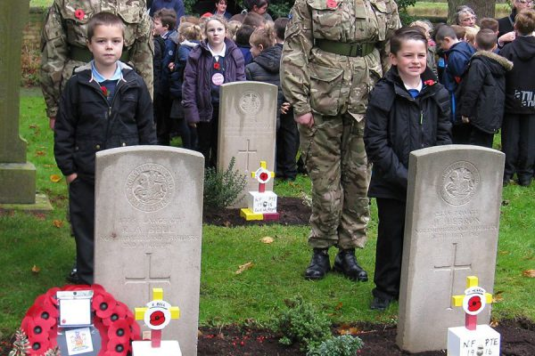 Children lay tributes at  neglected war graves