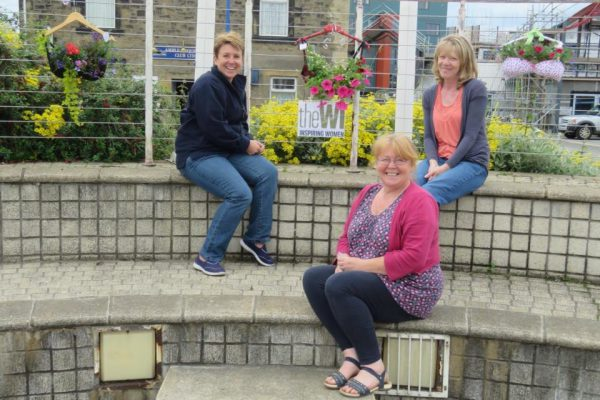 Amble WI's braskets adorn Town Square