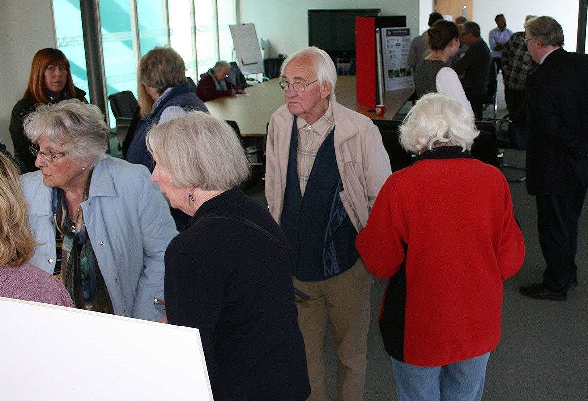 crowd-looking-at-housing-plans